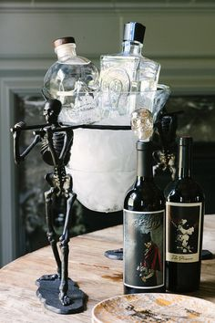 To achieve a sophisticated look that appeals to those too old to trick or treat, try ditching orange halloween decor and instead go dark.
