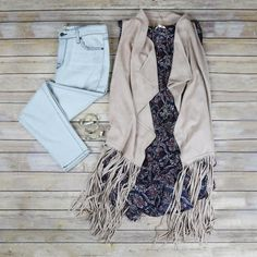 If you pick one out-of-the-box piece this season this sued fringe vest is it! Pairs great with a tank and denim, over a dress, or with palazzo pants for a truly 70's inspired look. #fringefrenzy #suedvest #ohmy #emiilebs #Frankenmuth