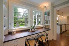 SEWING DESK & BUILT-INS BELOW WINDOW IN BASEMENT DESIGN    Built-Ins - traditional - home office - portland - Emerick Architects