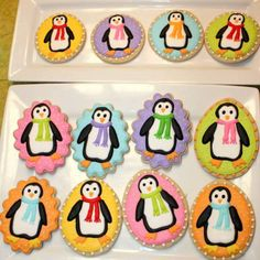 penguins in colorful winter gear that are cookies