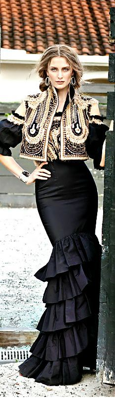 Black and gold dress with bolero style vest from Naeem Kahn. High fashion vaquera style - cowgirl chic.