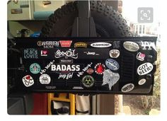 bumper stickers on the inside rear door of a Jeep Wrangler