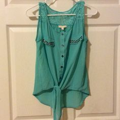 Beautiful high low chiffon blouse Beautiful sleeveless high low button-down chiffon blouse that ties in the front. Made of polyester, cotton, nylon and rayon this is a beautiful seafoam green color and is in excellent condition. Pearl by Melissa McCarthy Tops