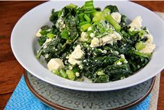 Boiled spinach drizzled with extra virgin olive oil, freshly squeezed lemon juice and topped with warm feta.