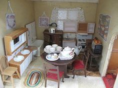 Large vintage wooden Doll's House containing approx fifty items of furnitur