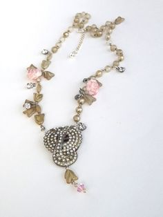 IMPERFECTION IS BEAUTY, A Repurposed Vintage Assemblage Necklace, created with an antique dress clip and vintage necklace