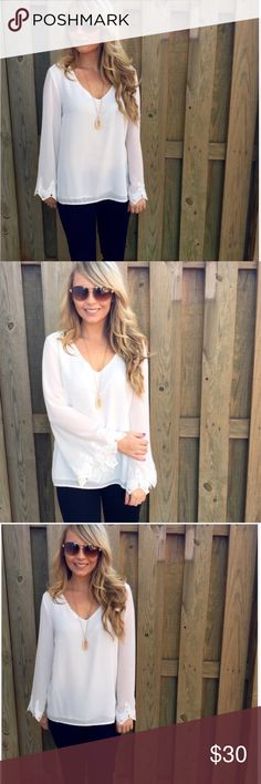 White bell sleeve top This top features long flared sleeves, a scalloped eyelash lace trim and a V-neckline.  -70% Silk  -30% Polyester   -Wearing size small Tops Blouses
