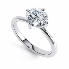 A beautiful diamond engagement ring in 18ct white gold with a twisted four prong claw. Featuring a stunning single round brilliant diamond to maximise sparkle. Ring profile: Court #engagement #diamond #ring #roundbrilliant #singlestone #solitaire #sparkle #jewellery