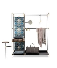 Pret-a-Porter is a cabinet/wardrobe made of steel tubular black painted frame , inox steel joints and mat gold finishing. It is available in many different versions and it is possible to choose optional accessories between mirror...