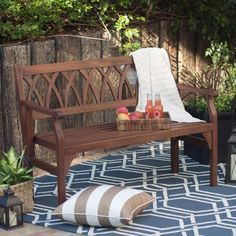 With its graceful, curved X-back detailing and handsome dark brown finish, this bench adds elegance to your patio or back yard.