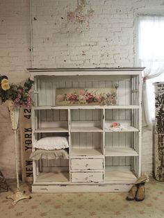 Shabby handmade cabinet   distressed paint finish on a bookcase made from salvaged wood and windows. The cabinet is gorgeous and fitting a french mudroom very much as a storage. It's just what you want to add shabby chic sophistication to the mudroom!