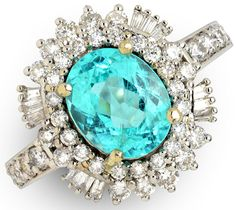Paraíba Tourmalines appear in a variety of hues, including violet, green, greenish blue, blue, & bluish green.  2.27 ct Paraiba Tourmaline Oval & 0.94 ctw Diamond Round & Baguette 18K White Gold Ring Size 7