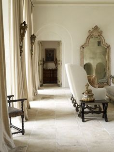 Venetian Plaster Walls, Limestone Floors- Bars de Beaucaire (Chateau Domingue)- can be used indoor/outdoor, has a creamy buttery tone and can also be used on countertops because of its thickness, Cream colored drapes