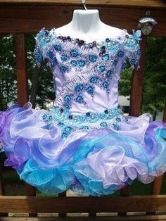 This is a purple and blue dress for a beautiful little girl
