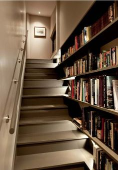Love this!  grey stairs & beautiful books. Always looking for more places to put my books!