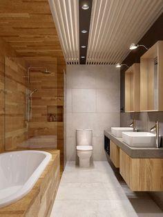 Salle de bain en bois et blanc. L'espace bain / douche est délimité par le bois.