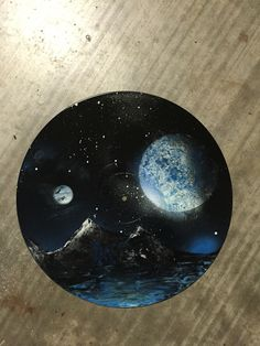 I painted this space scene on a vinyl record