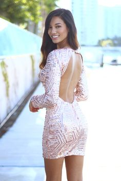 SO SPARKLY!! Wow, this stunning Blush Sequin Short Dress is a total MUST HAVE for the perfect new years eve!! It features long sleeves and full embellished sequins. An excellent piece for those special occasion that you need to just SHINE! See other lovely dresses at our trendy online boutique!