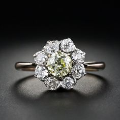 Victorian fancy yellow diamond daisy ring. Daisies and a yellow diamond. I need this.