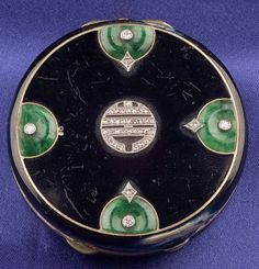 Art Deco Enamel, Jadeite and Diamond Compact, the en plein enamel case with jadeite pi motifs, rose and old European-cut diamond highlights, millegrain accents, 18kt gold and platinum mount, dia. 1 7/8 in