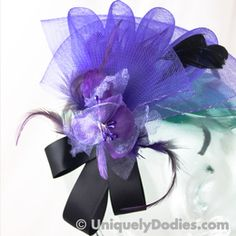 This outstanding purple fascinator is just right. With a lovely ruffled fan shape it measures 8 inches by 7 inches....