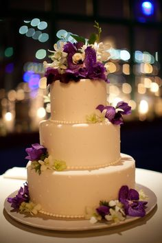 Purple flowers with a 3 tier cake