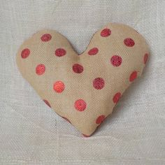 A personal favorite from my Etsy shop https://www.etsy.com/listing/492986358/heart-throw-pillow-red-polka-dot-burlap