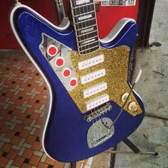 DiPinto Guitars Custom one-off Galaxie 4 Deluxe in blue sparkle with gold sparkle guard and headstock with mirrored switch plate