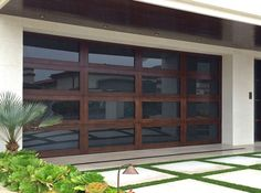 Glass Garage Door - If you are looking for a new update to the garage door . You can have glass in the garage door. Many garage door manufacturers are Custom Garage Doors, Garage Door Windows, Glass Garage Door, Wood Garage Doors, Barn Garage, Custom Garages, House Windows, Diy Garage, Garage Exterior