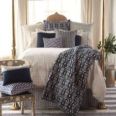 Bed dressed with antique American woven blankets, fragments made into pillows.  John Robshaw