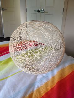 Homemade string lampshade. Beach ball, 100m of string, watered-down craft glue.