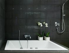 Amazing Black And White Bathroom Design With a Huge Custom Made Bathtub : Amazing Black And White Bathroom Design With A Huge Custom Made Bathtub With Black Natural Stone Walls And Shower Design White Bathroom Designs, Luxury Tub, White Apartment, Bathtub Design, Bathroom Design Black, Apartment Bathroom, Bathroom Design Luxury, Contemporary Bathroom Designs, White Bathroom