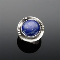 'Starry Night' Lapis Lazuli and Sterling Silver Ring  Lapis Lazuli is said to enhance one's awareness, insight and intellect. When I look at this ring, I see a 'Starry Night'.