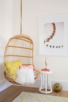 Hanging rattan swing reading nook | click to tour the entire girls bedroom