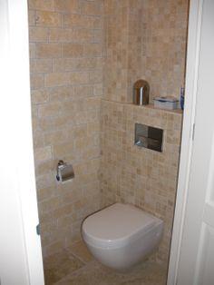 Travertin creme natuursteen in het toilet, Tegelhuys