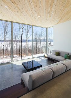 Acting as a landmark through the lush summer, the Nook Residence by @muarchitecture changes with the seasons and its whiteness blends into the winter landscape, paying homage to the great Quebec winters #glass #walls