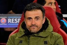 Barcelona's coach Luis Enrique sits in the dug out ahead of the UEFA Champions League round of 16 1st leg football match between Arsenal and Barcelona at the Emirates Stadium in London on February 23, 2016.
