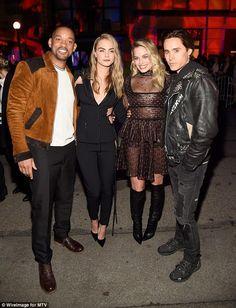 Team effort! Margot Robbie was hard to miss as she posed alongside Suicide Squadco-stars Will Smith, Cara Delevingne and Jared Leto at the 2016 MTV Movie Awards in Burbank, California on April 9, 2016