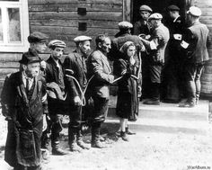 the Jewish people are tied up by Lithuanian guards  Poignant Photos of WWII Time | English Russia