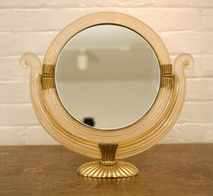 Elegant table mirror, design attributed to Gio Ponti image 3Hand blown glass possibly executed by Venini, with stylish golden supports.