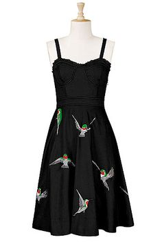 Cotton poplin dress with embroidered hummingbirds is ideal for summer dressing. The paneled structure of the corset style bodice with tiny ruffle trim makes this classic cut a super flattering choice in a fit-and-flare silhouette.