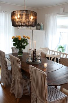 Great slipcovers and pendant lighting!