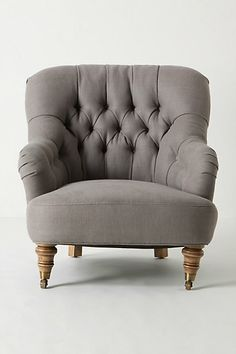This tufted linen rolled arm chair doesn't go with anything in my house, but it is gorgeous. I love the little turned legs with wheels too. Would look amazing in velvet.