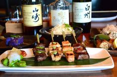 Yakitori skewers hot off the robata grill (with bacon, score!) by Chef Yo Matsuzaki from Zentan, D.C. | Best Japanese Restaurants in Washington DC - Thrillist.com #yum