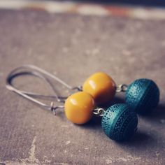 these earrings are made of vintage and plastic beads and copper long ear wires.    almost 3 long.