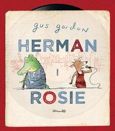 """""""Herman y Rosie"""" / Gus Gordon: Esta es una historia sobre una ciudad muy grande, sobre      perritos calientes y música y sobre el aire fresquito del metro      en verano. Una hsitoria de música en los terrados y de caramelos      de café con leche. Pero, sobre todo, es la historia de Rosie y      Herman."""