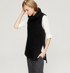 Cut with a soft ribbed front and textured back, this sleeveless knit exudes effortless. Turtleneck. Sleeveless. Split hi-lo hem.