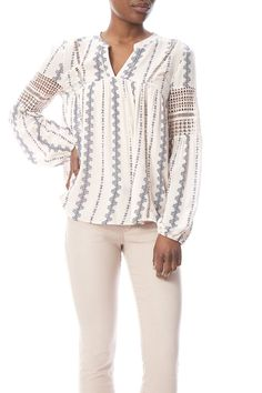 Soft pink and denim blue v-neck blouse has crocheted embellishments on the front and sleeve with an elasticized sleeve bottom and loose fitting style.   Crochet Panel Blouse by Blu Pepper. Clothing - Tops - Long Sleeve Clothing - Tops - Blouses & Shirts Wyoming