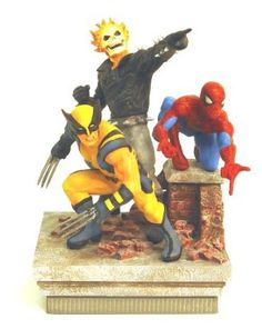 """Marvel Heroes - Deluxe Paperweight - Spider-Man, Ghost Rider, Wolverine (8"""" Group Statue) Marvel Heroes Deluxe Paperweight is made of Resin. Features detailed sculpts of Wolverine, Wolverine, and Spider-man fight ready! Attention to detail is impecable. Colorful and unique makes a great gift for your Super Hero collectors. Comes in 4 Color Box."""