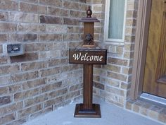WELCOME POST 2 --- FREE WELCOME SIGN INCLUDED -- SHIPS IN 1 BUSINESS DAY This elegant Welcome Post has a hand rubbed stain which has been top coated with poly to provide protection from the outdoors. The top and bottom are made of two different size boards which have each been routered